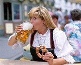 Germany, Bavaria,   Woman, young, traditional costume, stein, beer, drinks,  Breze, holding, portrait  Europe, Southern Germany, Upper Bavaria, party,...
