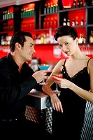Couple drinking at bar counter