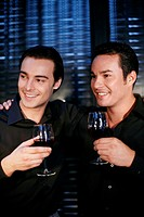 Men holding glasses of wine