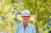 Woman with hat smiling at the camera