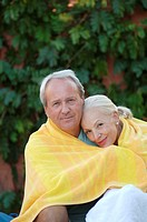 Old couple sharing a towel