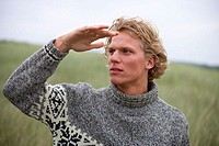 Dunes, man, young, stand, gesture,  Outlook, portrait,   Series, 20-30 years, blond, curls, rope sweater, turtleneck sweater, leisurewear, expression,...
