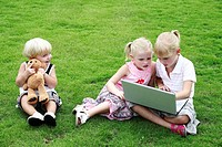 Children with laptop and toy bear (thumbnail)