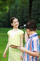 Boy recording images of girl