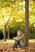 sitting woman, young, blond, meadow, foliage,  Log, leans,   Series, 20-30 years, knees, head, thoughtful, thought-deep, resting  sorrowfully, melanch...
