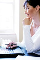 Woman thinking while using laptop (thumbnail)