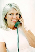 Woman smiling while talking on the phone