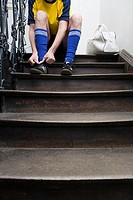 Stairwell, soccer players, stairways, sitting, football shoes, accelerates, detail,  no property release,  Man, football jersey, sneakers, shoelaces, ...