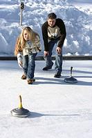couple, young, Eisstockschießen, happy,    Series, 20-30 years, friends, friendship, shoots Eisfläche, Eisstöcke, activity, sport, game hobby together...