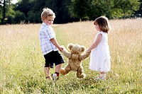 Children holding a teddy bear