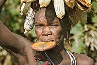 Surma woman carrying corn. Near Kibish. Ethiopia.