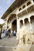 Tourists entering through the main door of the City Palace. Jaipur. Rajasthan. India