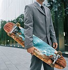 Businessman Carrying Skateboard (thumbnail)