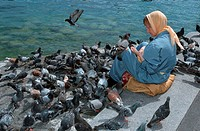 Woman, feeding, pigeons, Lucerne, Switzerland