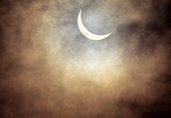 Hawaii, Oahu, Waianae, View of solar eclipse through clouds, July 1991
