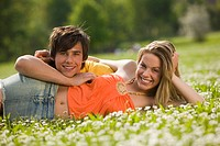 Young couple lying in meadow