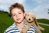 Boy (4-7) with toy dog on shoulder, portrait, close-up