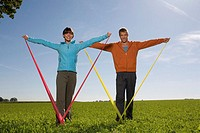 Young couple exercising with resistance band