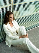 Businesswomn sitting on floor, portrait
