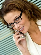 Businesswoman using mobile phone, close-up