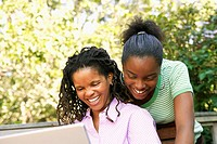 Young African women using a laptop outdoors