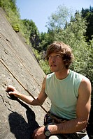 Young man in climbing wall, portrait