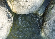 Stones and flowing water, close-up