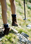 Hiker, view of legs and walking stick, close-up