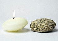 Candle and stone