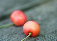 Cherries on wooden surface