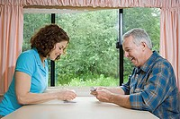Mature couple playing cards (thumbnail)