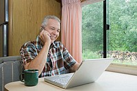 Man using a laptop computer in caravan