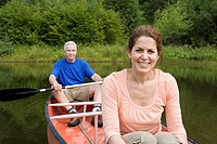 Mature couple canoeing