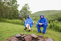 Mature couple wearing raincoats