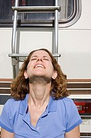 Woman sunbathing near a caravan