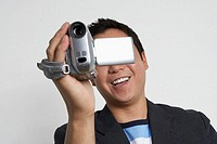 Man using video camera