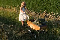 Little girl with baby carriage (thumbnail)