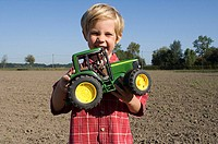 Boy with a toy tractor