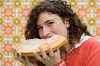 Girl eating a big piece of cake