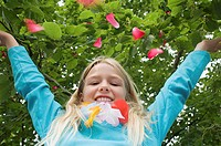 Girl throwing petals in the air