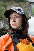 Female kayaker wearing a helmet