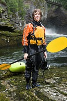 Female kayaker near river