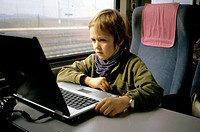 Boy watching film in laptop computer, tran