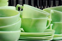 1950´s Vintage Green Glass Dishes displayed at an outdoor flea market