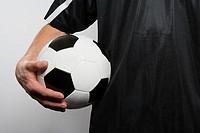 Footballer holding football