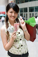 Young woman displaying money
