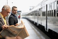 Businessman on Train Platform