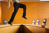 Businessman Walking on Table