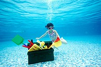 Girl Diving For Toy box Underwater