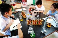 Two Elementary Students in Chemistry Class